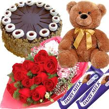 Teddy, cake, chocolates and flowers