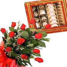 Red roses bouquet and indian sweets.