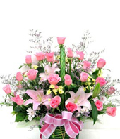 lilies and carnations in a wicker basket